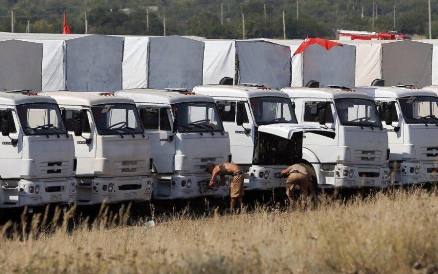 Белые КамАЗы с российской помощью прибыли на КПП на границе Украины