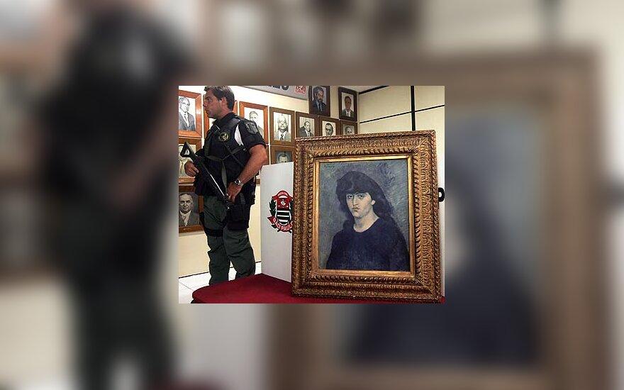 Policininkas saugo Pablo Picasso paveikslą