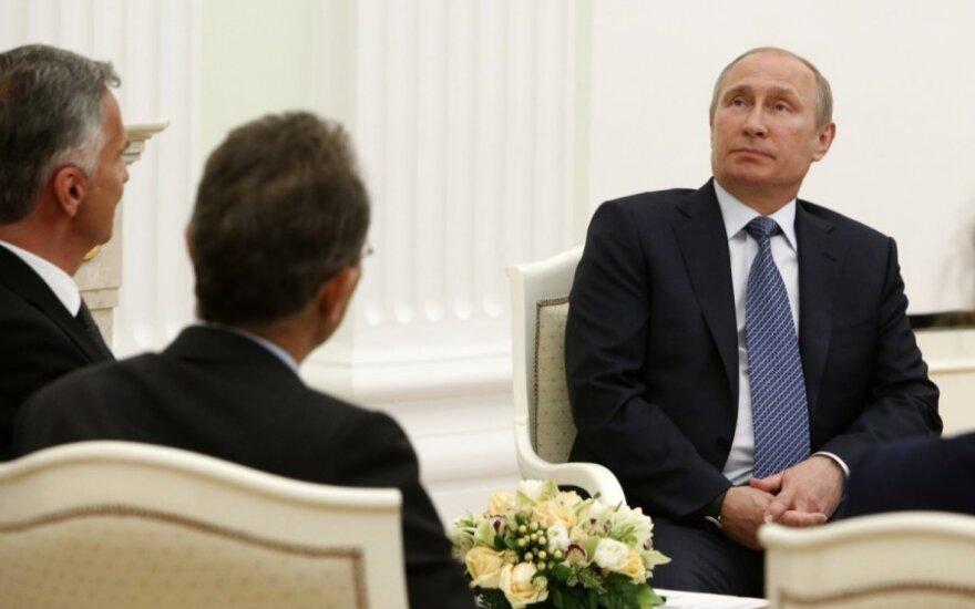 Vladimiras Putinas ir Didier Burkhalteris
