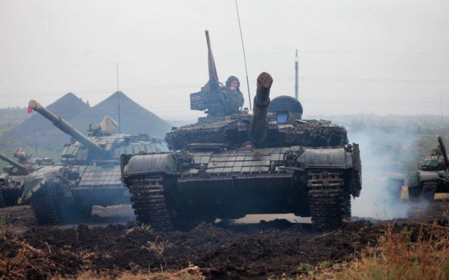 Минск: вооружения в Донбассе решено отводить в два этапа