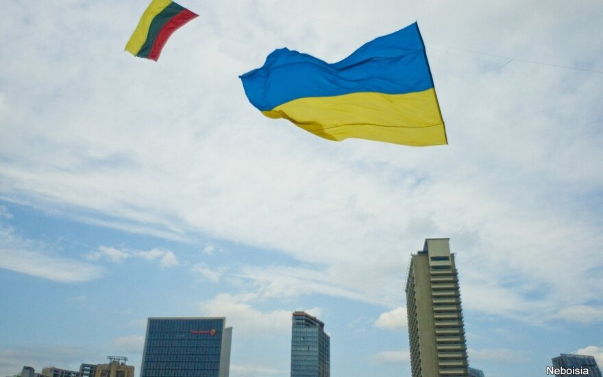 Ukrainian and Lithuanian flag in the Vilnius' sky