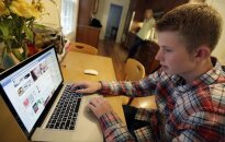 Teenager in the front of computer