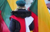 Polish girl with Lithuania's national flag