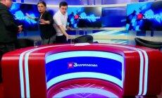 Karšti Gruzijos politikų debatai pasibaigė susistumdymu tiesioginiame eteryje