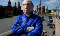 Romanas Roslovcevas su V. Putino kauke