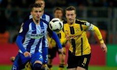 Peteris Pekarikas (Hertha) ir Marco Reusas (Borussia D.)