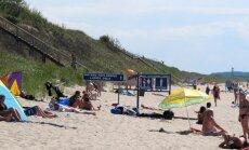 Nidoje moterų paplūdimį nuo bendro skiria tik ženklas