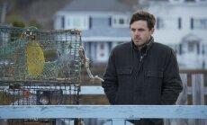 Casey Affleckas, kadras iš filmo Mančesteris prie jūros