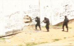 Brazilijos kalėjime kovojančias gaujas policija atskyrė jūriniais konteineriais