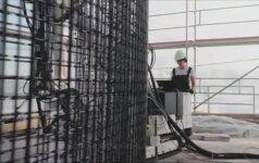 Šveicarijoje atsisakyta statybininkų paslaugų - namą stato robotai