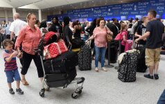 """Po keturias dienas trukusių problemų """"British Airways"""" atnaujino skrydžius"""