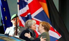 Angela Merkel ir Theresa May