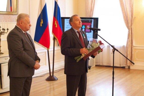 V. Putinas medaliu apdovanojo VSD ataskaitoje minimą Lietuvos politiką