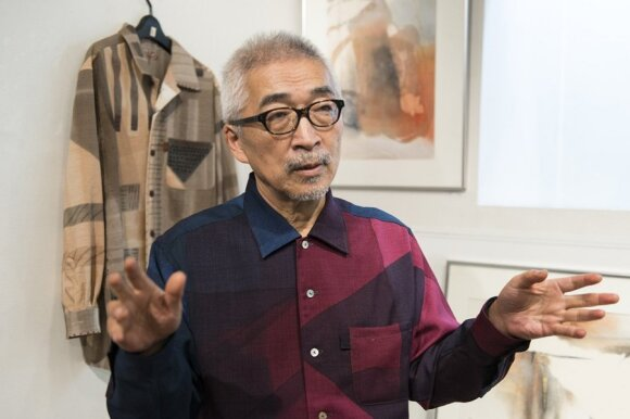 Japanese textile artist Hiroshi Saito with some of his creations   Photo Ludo Segers