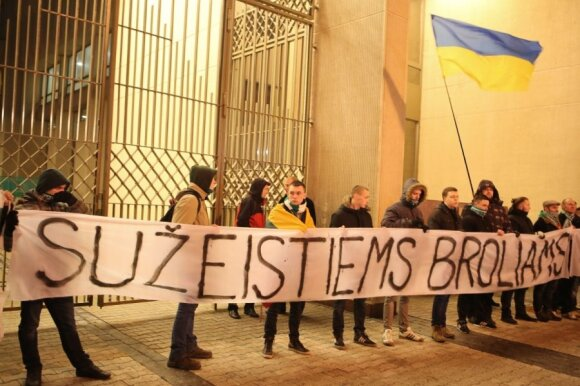 "Lithuanians held a rally by the Seimas in Vilnius to express their solidarity with ""the wounded brothers"", as the banner says."