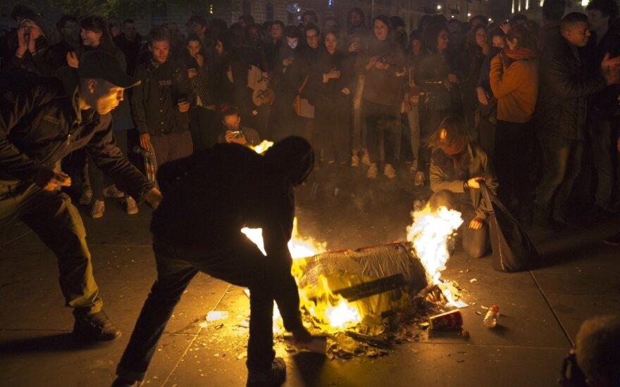 """Nesibaigiant protestams Macronas tikisi """"greito kompromiso"""" pensijų reformos klausimu"""