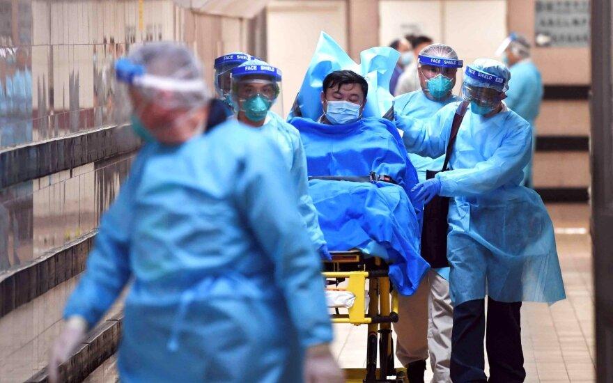 JTO koronaviruso pasaulinę grėsmę vertina kaip aukštą