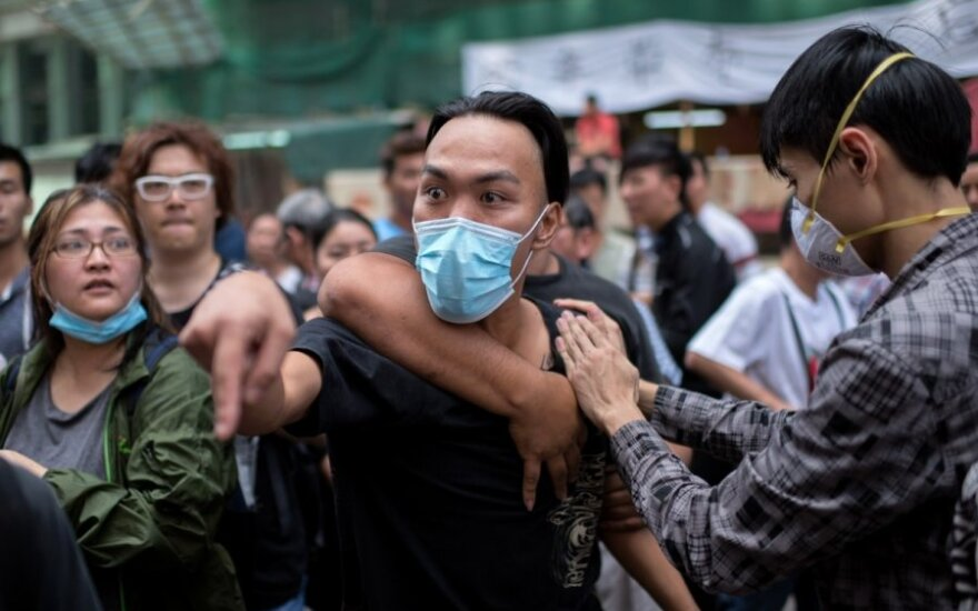 Honkonge vyksta pirmi rinkimai po demokratijos šalininkų protestų