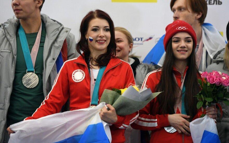 Rusija grįžusius olimpinius atletus sutiko kaip didvyrius