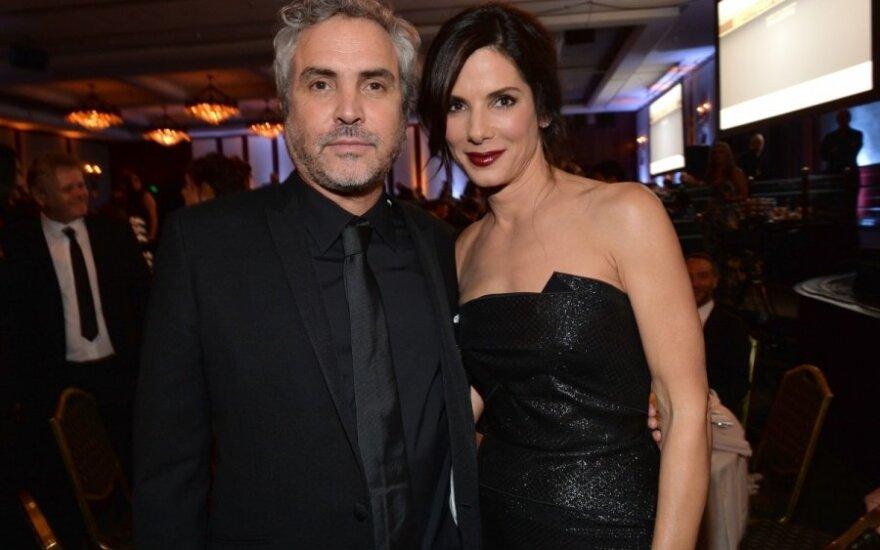 Alfonso Cuaronas ir Sandra Bullock