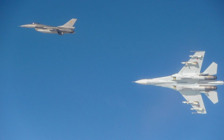 NATO fighter-jets escorting Russian fighter-jet