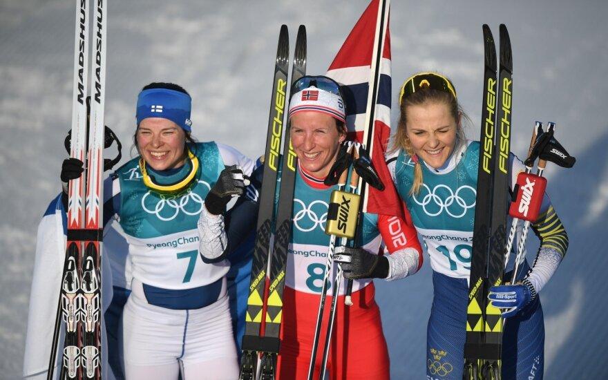 Norvegė Marit Bjorgen, iš kairės  suomė Krista Parmakoski, iš dešinės - švedė Stina Nilsson