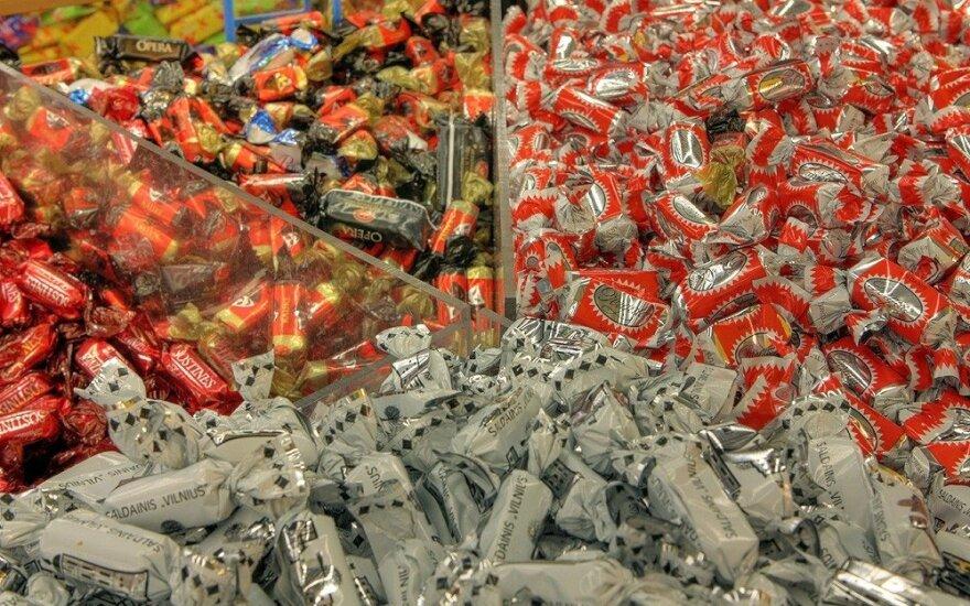 """Suvalgė saldainį """"Rimi"""" parduotuvėje – apsauginio reakcija buvo neadekvati"""
