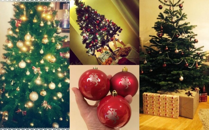 Garsūs žmonės puošia kalėdines eglutes