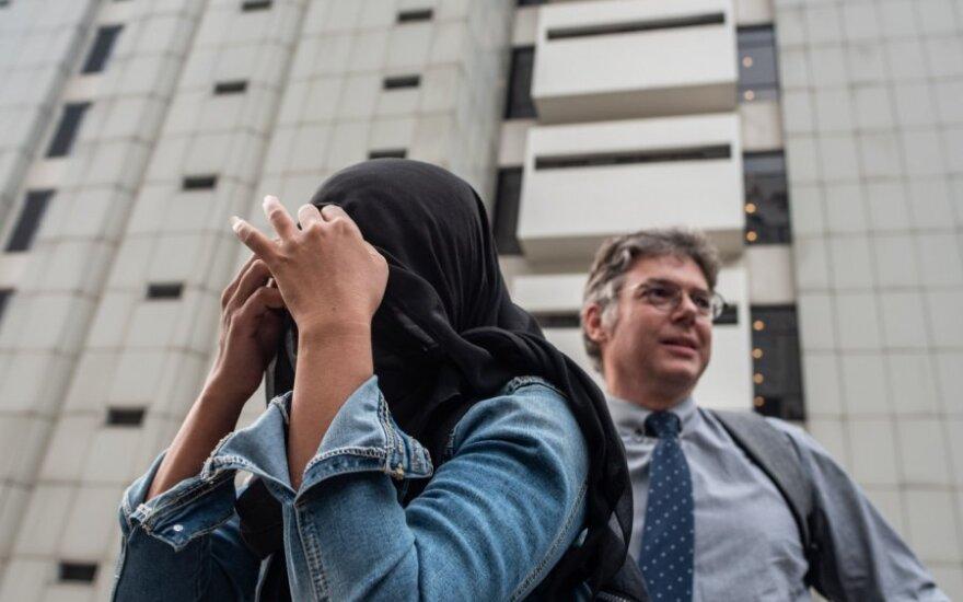 Khaw Kim-sunas atgabenamas į teismo salę