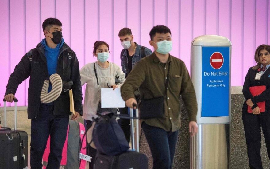 Naujojo koronaviruso protrūkis pasiekė Indiją ir Filipinus