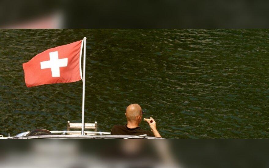 Šveicarija pradėjo taikyti apribojimus sankcijų sąraše atsidūrusiems Rusijos piliečiams