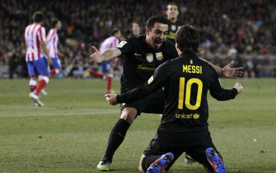 Xavi ir Lionelis Messi