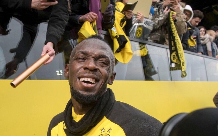"""Usaina Boltas """"Borussia"""" ekipos treniruotėje"""