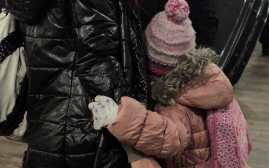 Sugrįžę emigrantai Kauno oro uoste