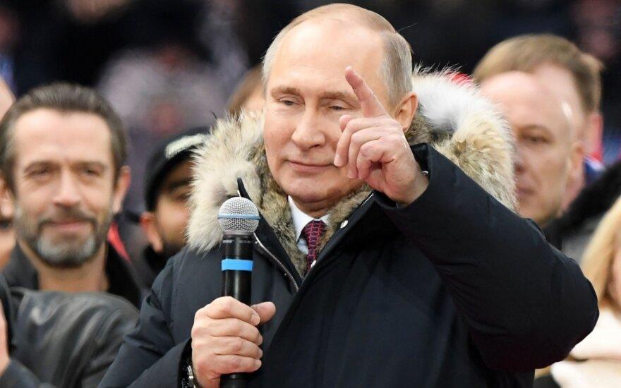 Putinas nežada JAV išduoti kibernetinėmis atakomis kaltinamų rusų