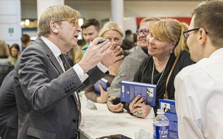 Even when signing books always the consumate politician, Guy Verhofstadt at the  Vilnius Book Fair  Photo © Ludo Segers @ The Lithuania Tribune