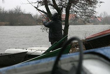 Žvejys Mingės kaime prie Minijos