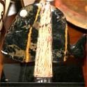 D. Mečkovskio sukurta marmurinė žuvis
